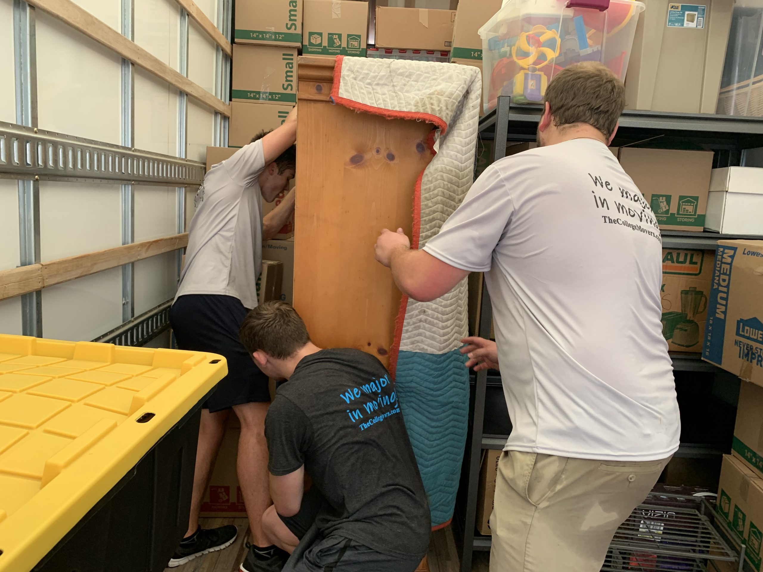 3 College Movers in Cedar Rapids loading moving truck